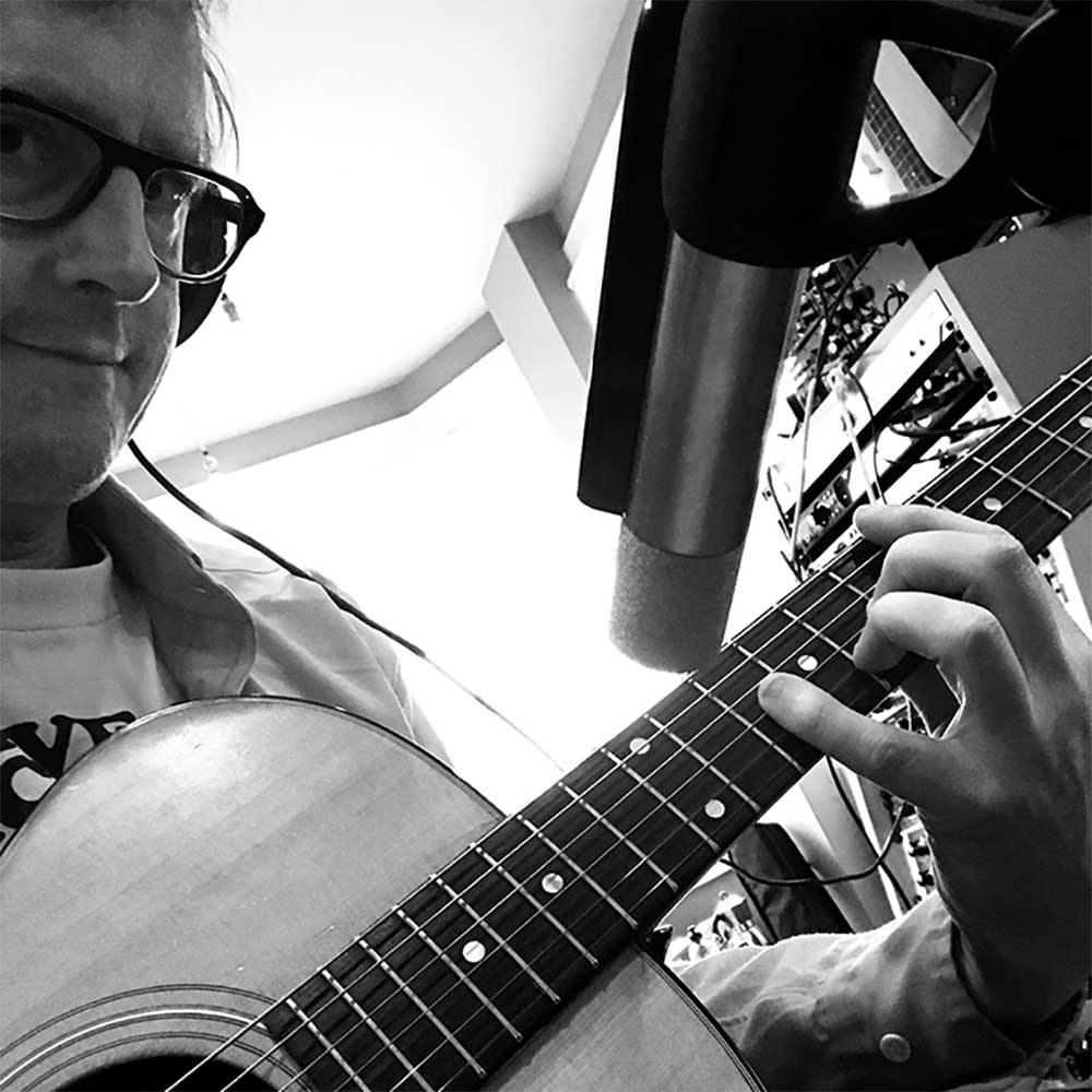 Jez Ashurst recording his guitar